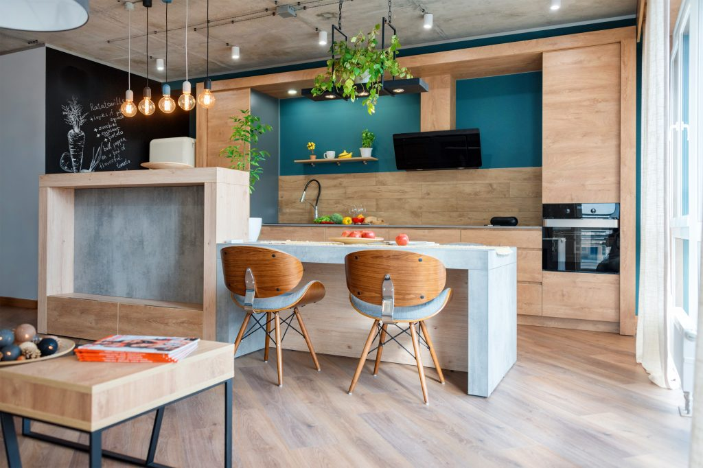 Modern Furniture In Luxury Kitchen. Minimalist Scandinavian Interior In Loft Apartment With Wooden Furniture, Lamps, Concrete Elements And Plants